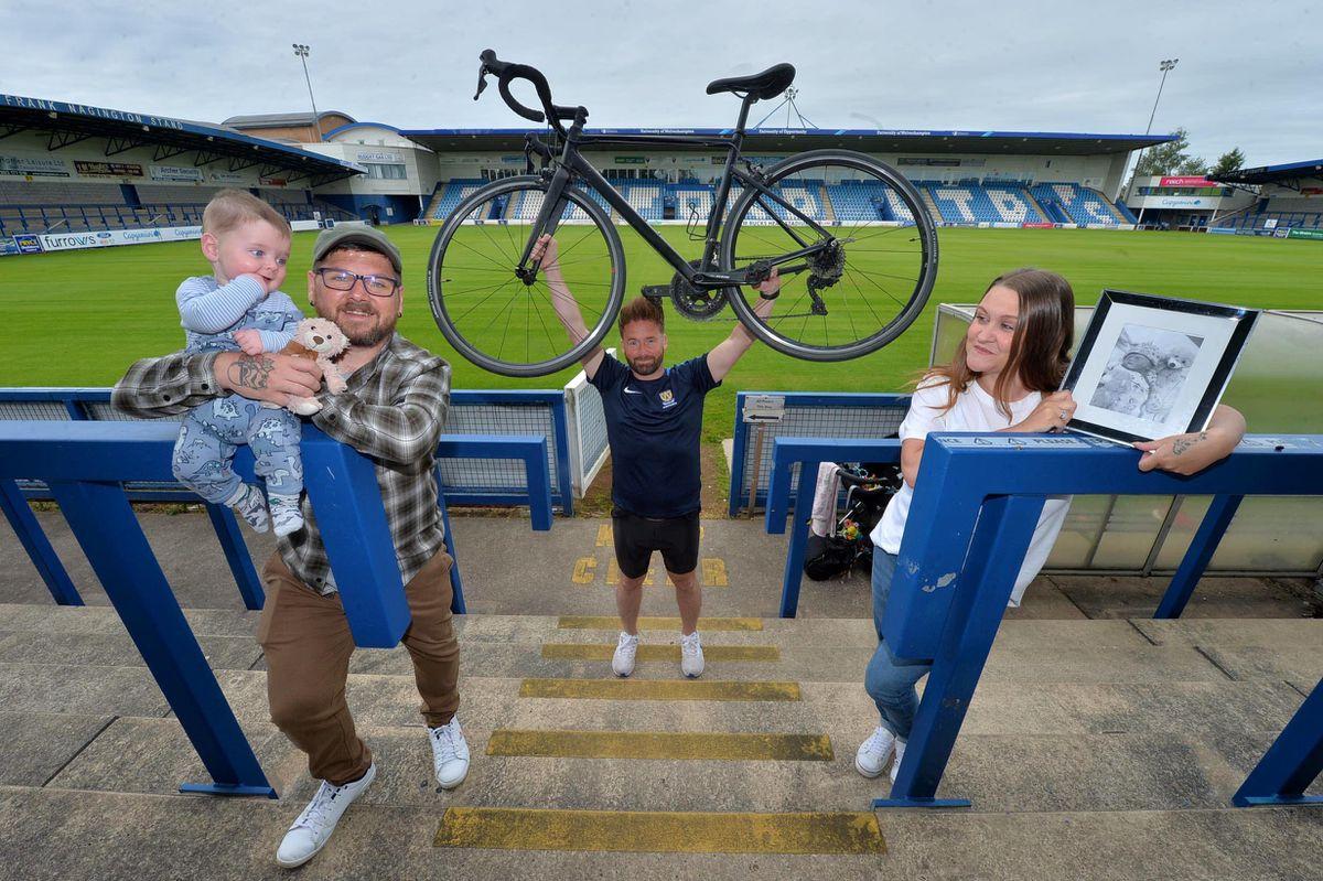 Cyclist, Ian Preece, with Victoria Vespa holding a picture of Luna-Seren, Allen Vespa and sixth month old Jude Vespa