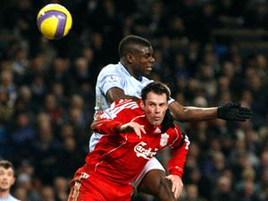 Manchester City's Micah Richards and Liverpool's Jamie Carragher battle for the ball