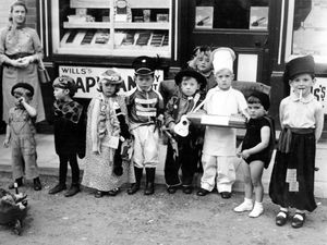 nostalgia pic. Clun. Clun carnival fancy dress. This emailed in by Patrick Wood jpwood13@gmail.com who said: 'Re PICTURES FROM THE PAST                                                                          Clun carnival approx 1954 1955 I am the cowboy [now 70! ] my mother Jean Wood Nee Brereton in background we do not seem to be very happy about the event !          Patrick Wood  Mountain Ash , Chelmick Drive Church Stretton sy67bp'. Carnivals. Library code: Clun nostalgia 2020..