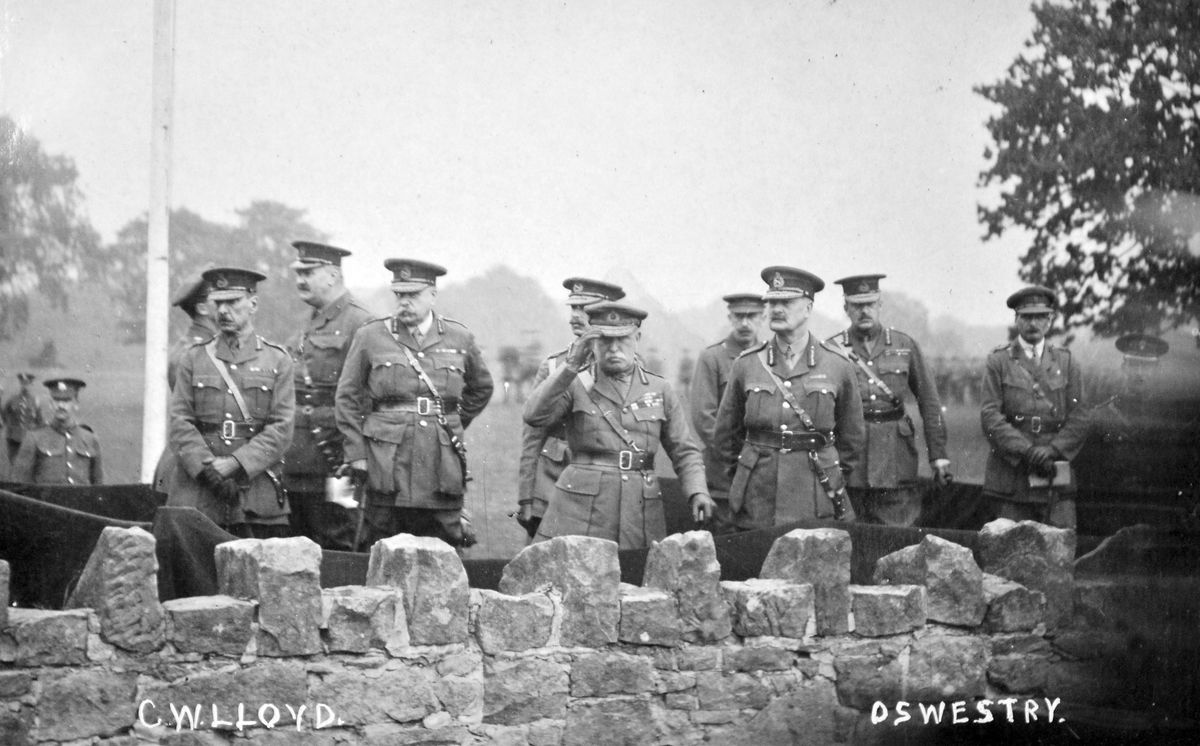 """Great War historians, here's a gauntlet thrown down in front of you. The only information with this postcard from the collection of Ray Farlow is """"C W Lloyd"""" and """"Oswestry"""" printed on the front, but they are clearly British Army top brass from the Great War era. But who are they? And what are they doing at Oswestry? The much decorated officer centre looks like Sir John French, and could that be Sir Douglas Haig third from left?"""