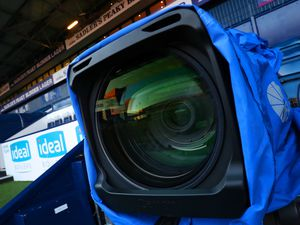 Close up view of a SKY TV / Television camera lens at the side of the pitch (AMA)