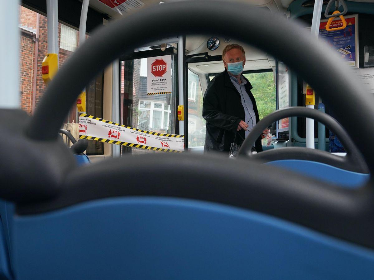 A passenger boards a bus