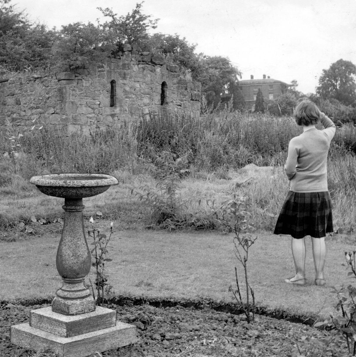The ruined Norman chapel at Malinslee, pictured on August 15, 1962. According to legend there was a secret passage connecting it to Malinslee Hall in the distance. Jeremy Corbyn's mother was instrumental in saving the chapel from destruction – it was dismantled and rebuilt.