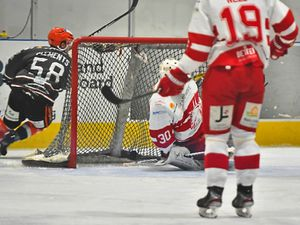 David Clements circles round the net after scoring  Picture: Steve Brodie