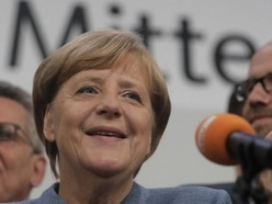 Angela Merkel wins fourth term as nationalists enter German parliament