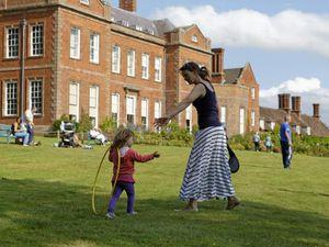 A family playing in the gardens of the Dudmaston Estate, near Bridgnorth