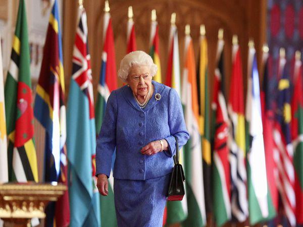 Queen in front of flags