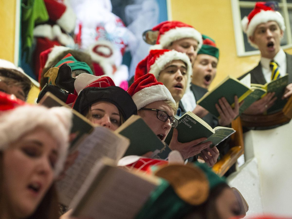 Door-to-door carol singers must only gather in groups of six maximum, new guidance states (Lauren Hurley/PA)