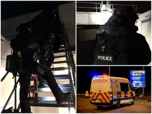 Armed police scaled the roof of Tesco Extra, in Shrewsbury, after reports of a gunman sparked a major alert. Police images: West Mercia Police. Street image: Jamie Rickets/Shropshire Star