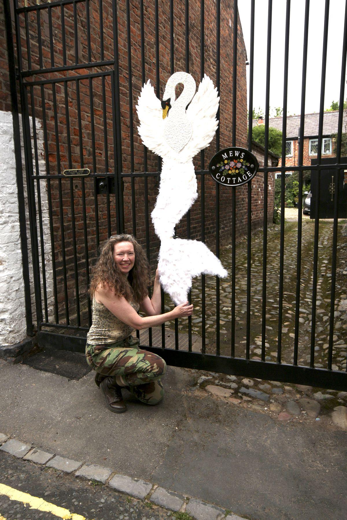Sally Poynton with her figure. Photo: David Atkinson