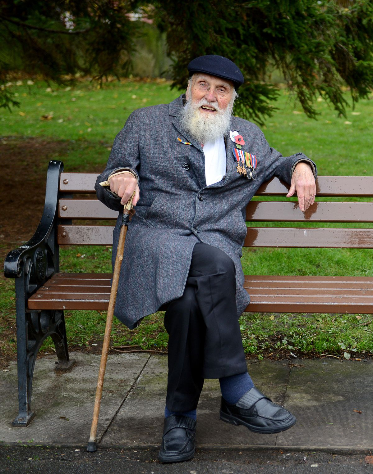 George Evans takes a seat in Wellington church yard after a Remembrance Service