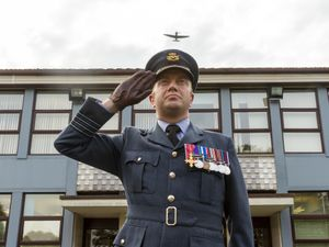 Station Commander Gareth Bryant salutes the Spitfire flypast for the Battle of Britain anniversary. Photo: Sam Dale.