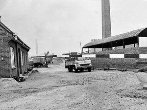 """nostalgia pic. Hadley. The entrance to Blockley's brickworks in Hadley on Monday, October 2, 1972. This picture was published in the Shropshire Star on that day with the caption 'the deserted entrance to Blockley's today' and the accompanying story, which was a front page lead, began: 'Between 50 and 60 men who went on strike last week returned to their Hadley brickworks today to find themselves locked out, according to union officials. The men at Blockleys Ltd, who struck for higher piecework prices, decided on Saturday to return to work today. But said their union's regional official Mr Eric Timmins, their cards were removed from the clocking-in machine. 'The men could not clock in. This is a lockout,"""" said Mr Timmins, of the General and Municipal Workers' Union."""" This is a print in the Shropshire Star picture archive and has the Shropshire Star copyright stamp. The photographer was Richard Burt. Strikes. Industrial relations. Hadley strike. Library code: Hadley nostalgia 2020.."""