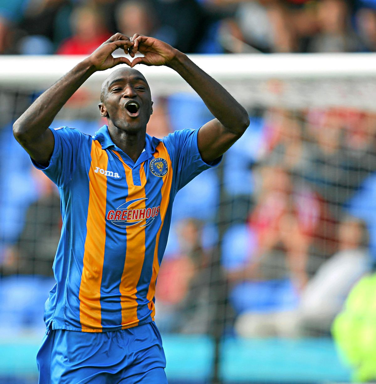 Marvin Morgan celebrates in Shrews blue and amber