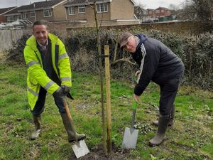 Environmental officer Adrian Corney getting stuck in with Dave Kirk