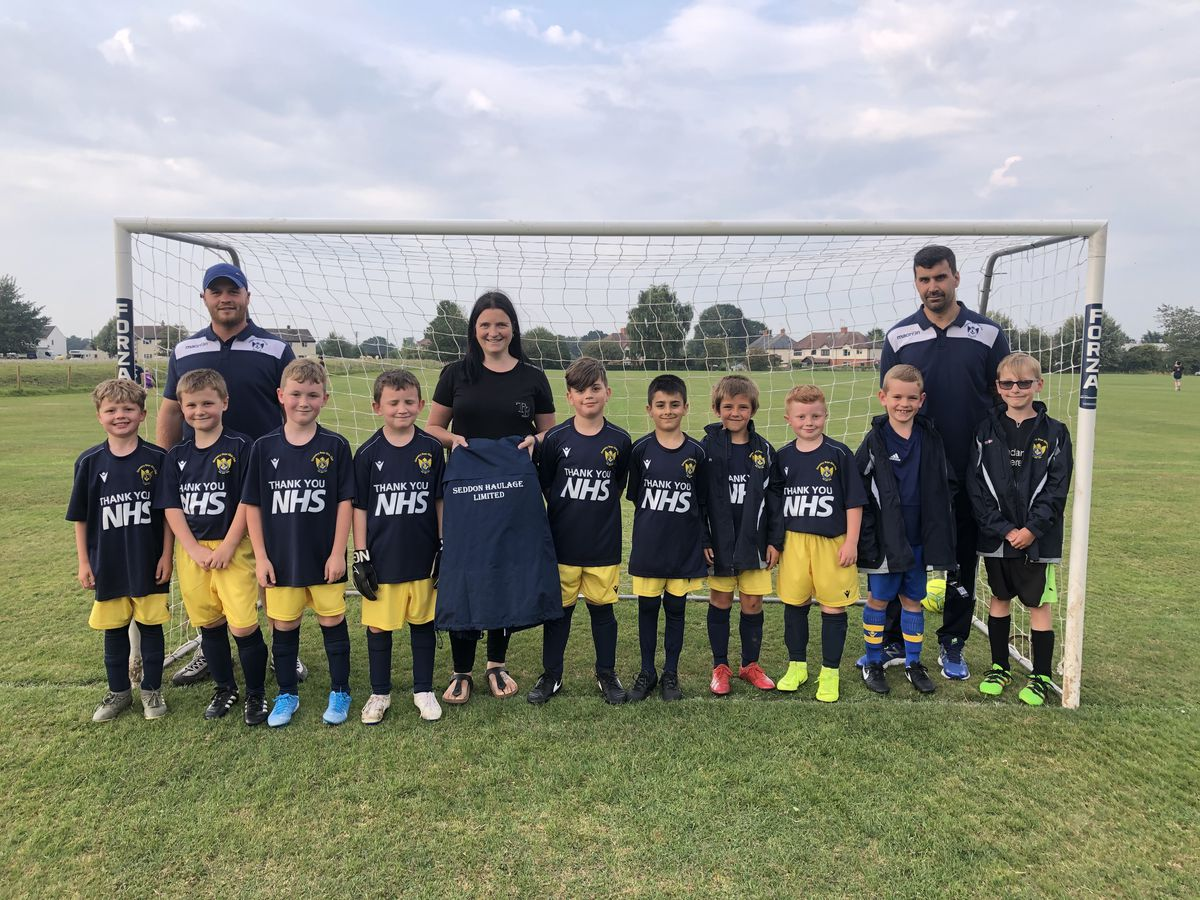 The boys of Oswestry Boys & Girls Club under-nine Tigers in their 'Thank You NHS' kits, pictured with, from left, manager Anthony Butler, Laura Seddon of Seddon Haulage and assistant manager Craig Walker