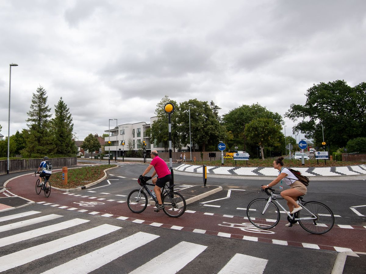 Cyclists using roundabout which prioritises bikes (Joe Giddens/PA)