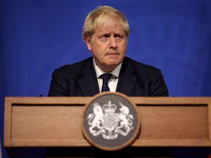 Prime Minister Boris Johnson speaking at a lectern