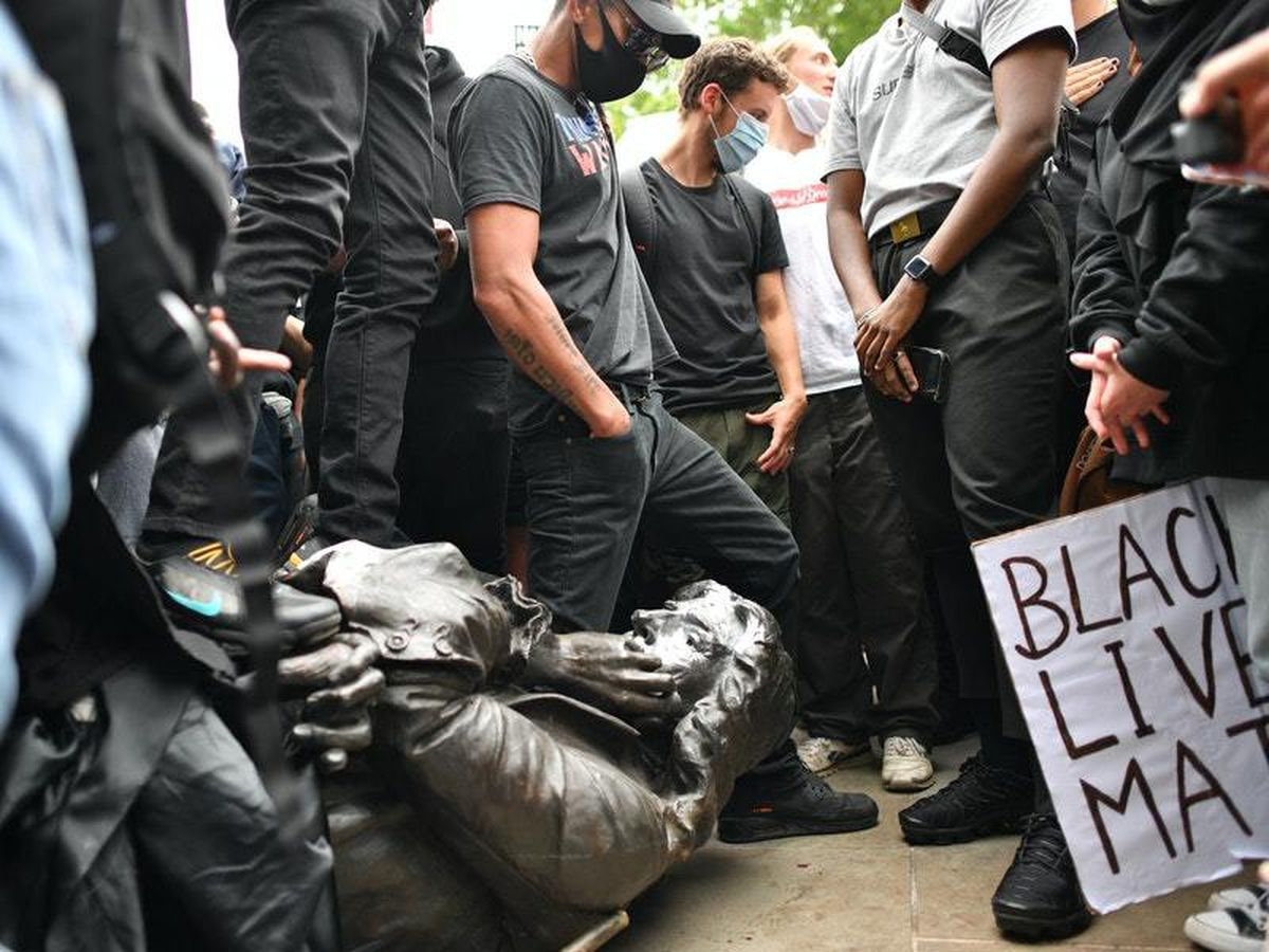 Protesters pull down a statue of Edward Colston during a Black Lives Matter protest rally
