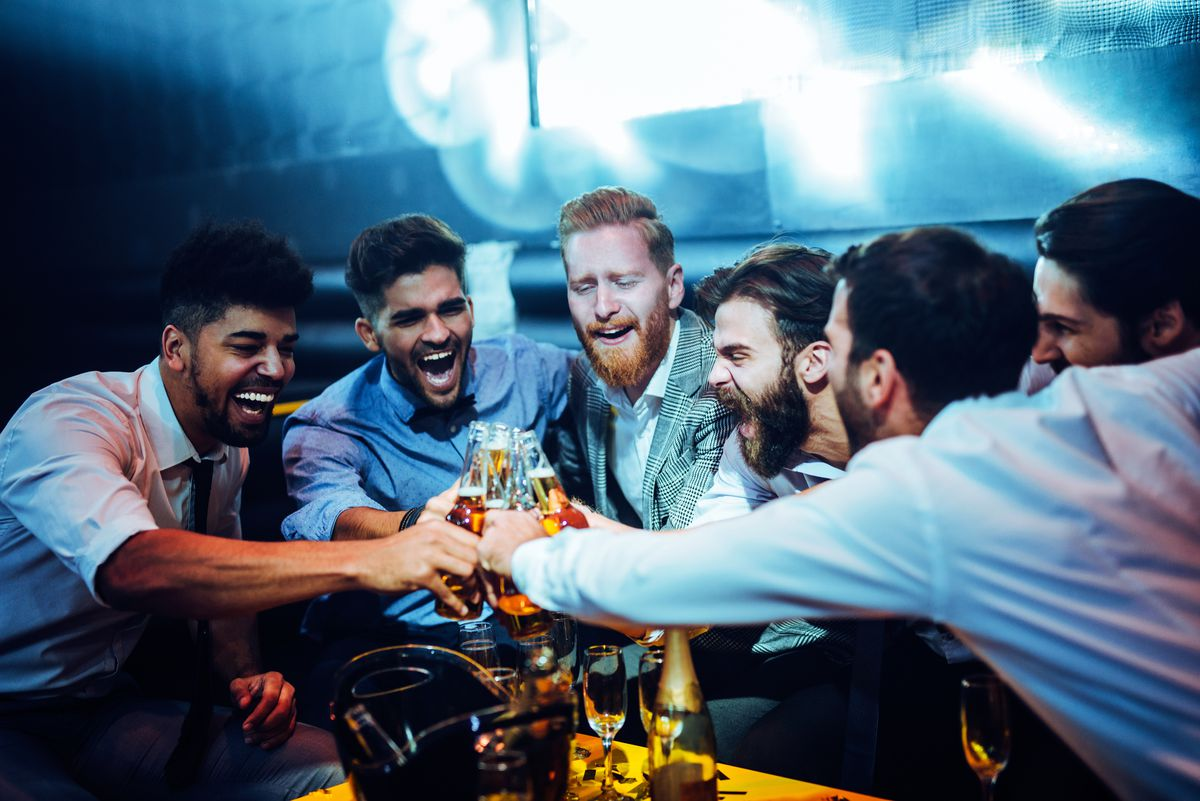 Men toasting in the club