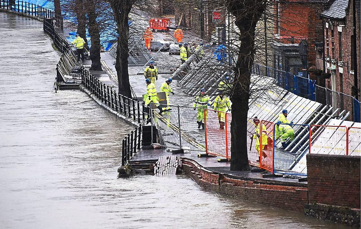 The flood barriers in Ironbridge had to be repaired after they were forced back by the water, gouging deep grooves in the road
