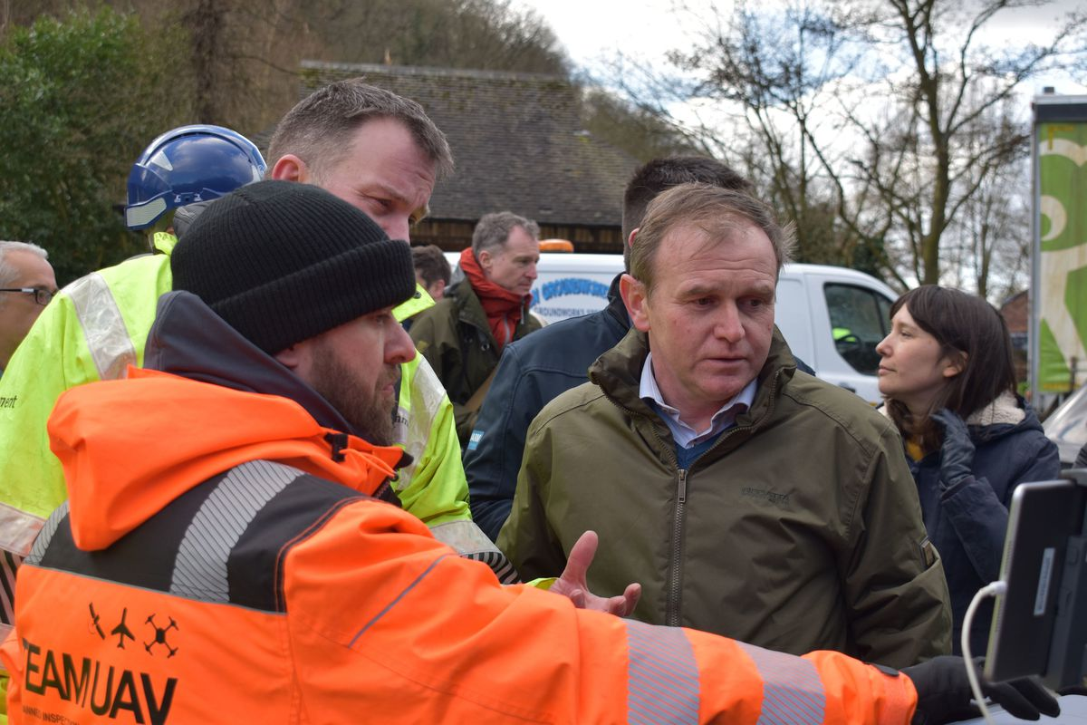 Environment Secretary George Eustice views a screen showing drone camera images of flood defences