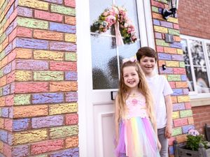Harper Morgan, five, and big brother Carter, seven, proudly show off their handiwork