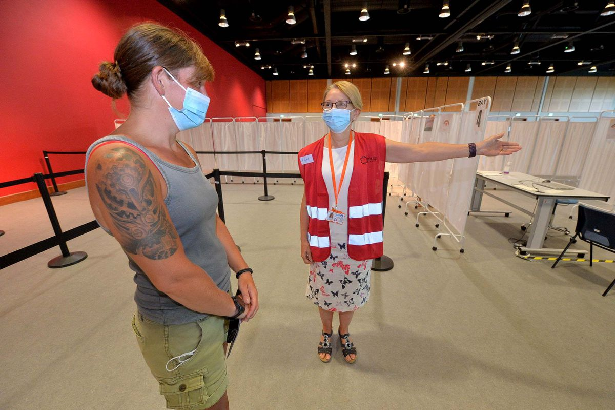 Volunteer Pam McPhillips guides Abby Winchester from RAF Cosford at the International Centre, Telford