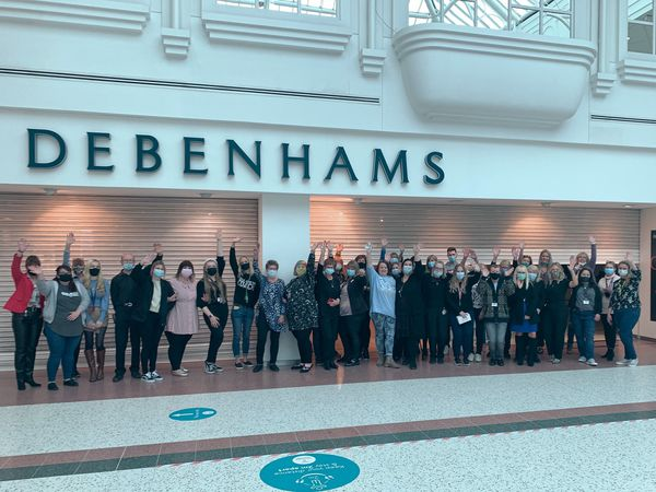 Staff created a party-like atmosphere despite their sadness as Debenhams closed the doors of its branch in Telford on its final day of trading. Photo: Amy Marie Bailey