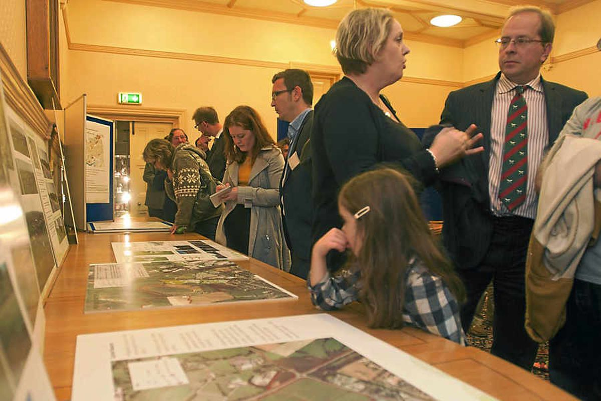 Residents attend the public consultation on Oswestry hillfort plans at the Guildhall which followed a visit to the landmark