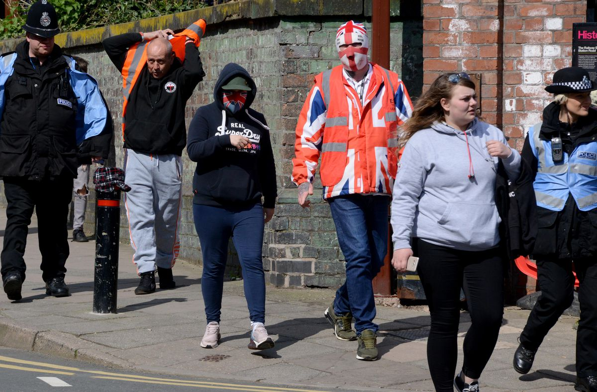 Part of the small EDL group walking to the square