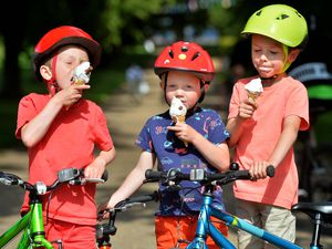 Ice Creams all round in Shrewsbury's Quarry for Owen Read, six, Jack Read, five, and Lucas Read, eight, from Much Wenlock
