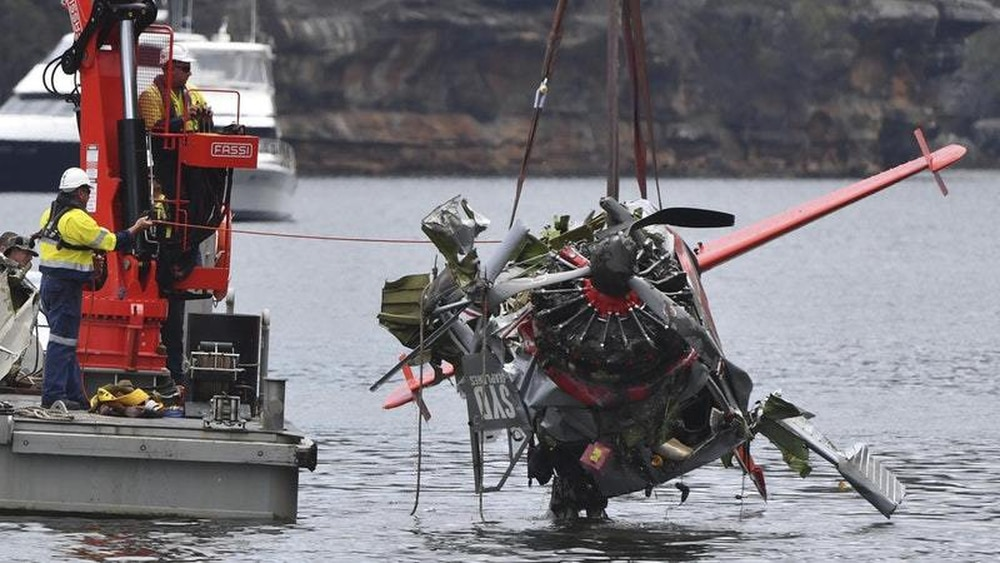 Tributes flow for seaplane crash victims, as family arrives in Sydney