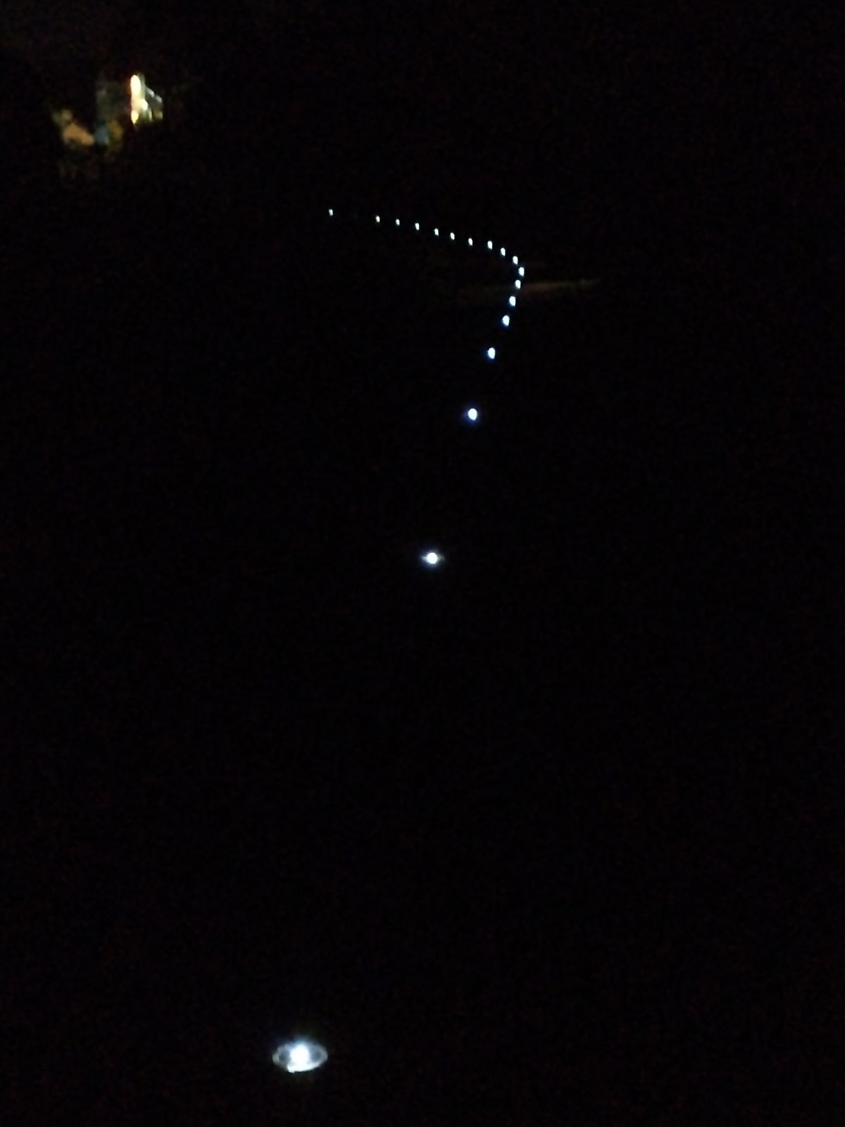 The solar lights working at night along the towpath