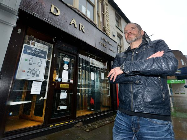 Charlie Adlard outside Adlards Tobacconists which has closed its doors for good
