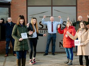 Stans Superstore in Oswestry is celebrating what would have been Stan Faulks' 100th Birthday. From left; Robert Faulks, Sarah Dodsworth (Front), Bethan Faulks, Andrew Faulks, Lisa Faulks, Peter Faulks and Katie Chaplin.