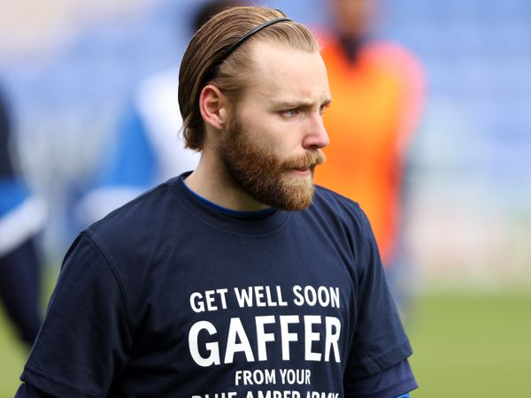 Harry Chapman of Shrewsbury Town wears a t-shirt saying get well soon to manager Steve Cotterill who has been suffering with the Covid-19 Coronavirus.