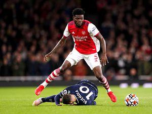 Aston Villa's Emiliano Buendia (bottom) goes down