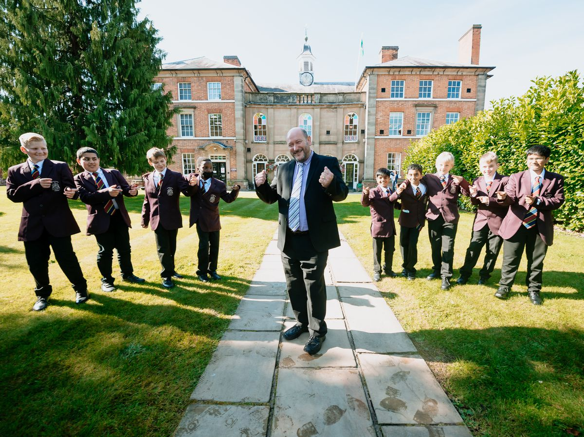 Don Fear and students at Haberdashers' Adams Grammar School in Newport