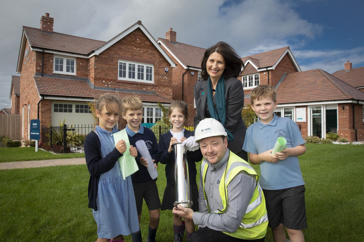 Children from St James' Primary School with homes advisor Michelle Underwood and site manager Carl Noble. Photo: Mandy Jones.
