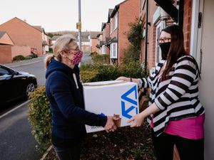 Kay Badley delivering a box of meat to Sarah Jenks from Telford