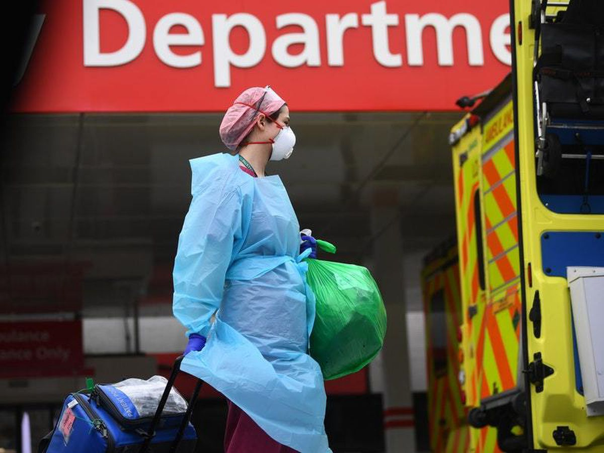 A member of hospital staff wearing personal protective equipment