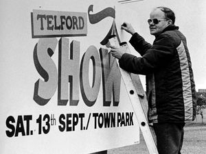 Telford Society volunteer John Saunders puts up one of the signs for the 1986 Telford Show – as Telford Super Saturday had been renamed.