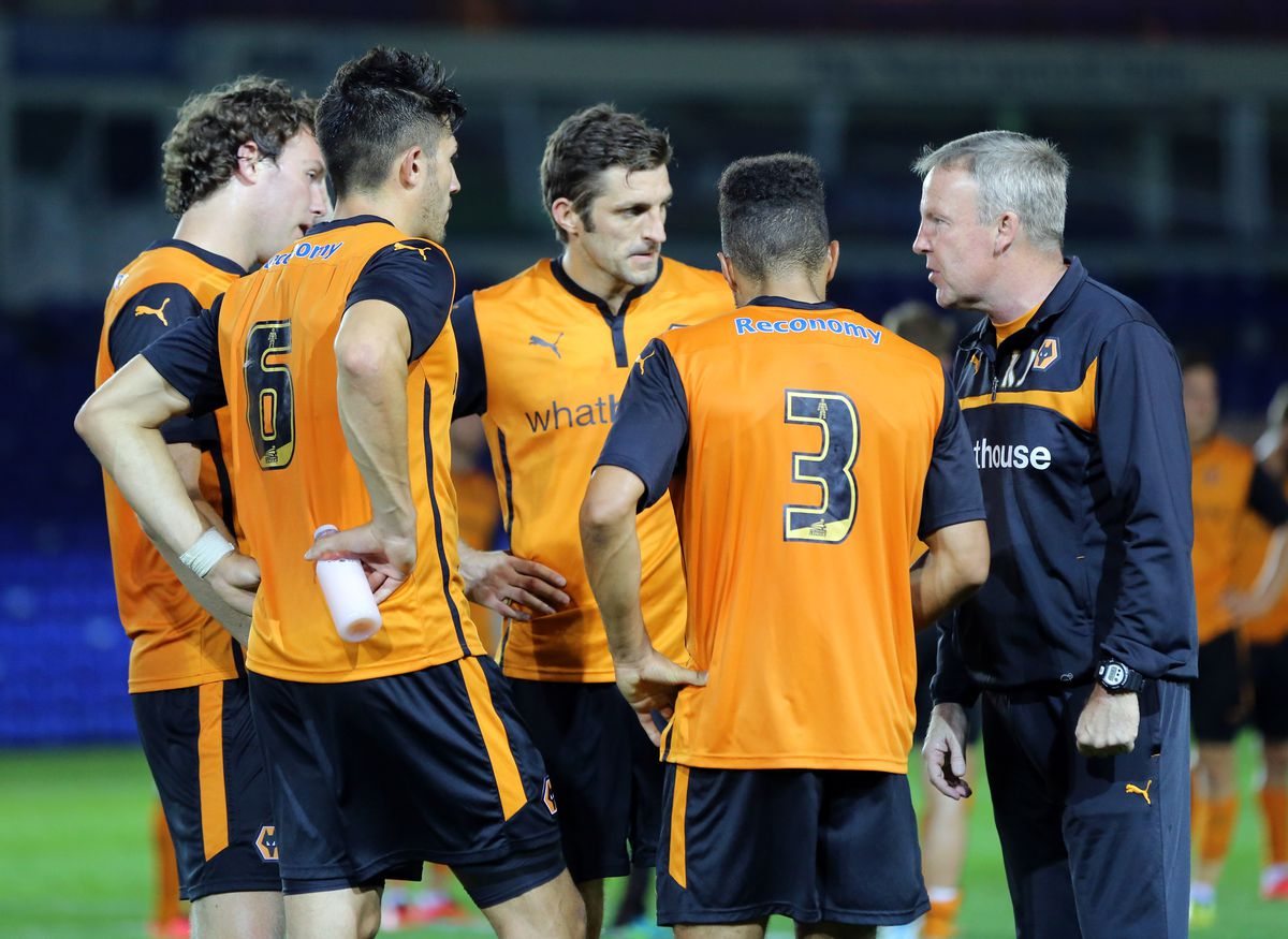 Golbourne and Wolves team-mates, among them his future Shrews boss Sam Ricketts, chat with their boss Kenny Jackett (AMA)