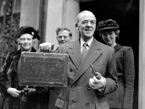 Sir Stafford Cripps, Labour chancellor of the exchequer, pictured leaving Downing Street for the House of Commons to present his Budget (PA)