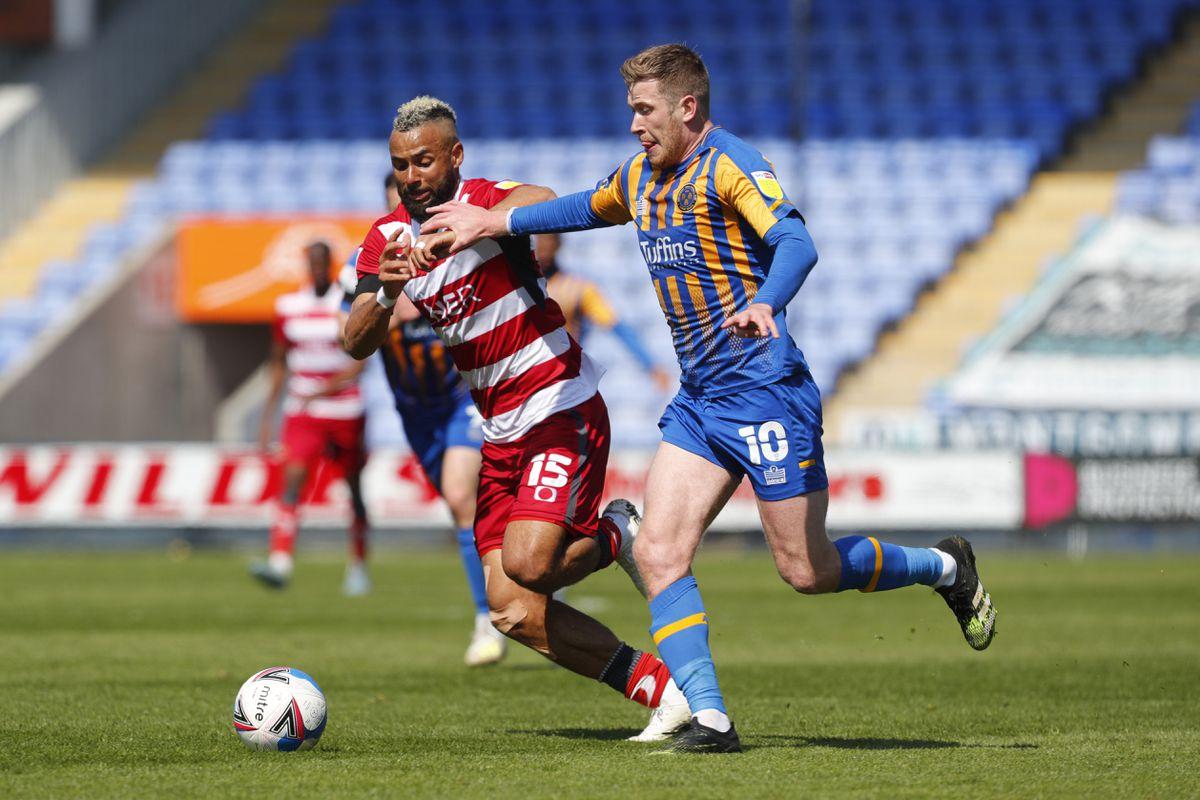 Josh Vela of Shrewsbury Town and John Bostock of Doncaster Rovers. (AMA)