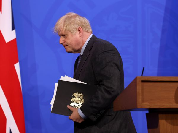 Prime Minister Boris Johnson leaves after the media briefing in Downing Street