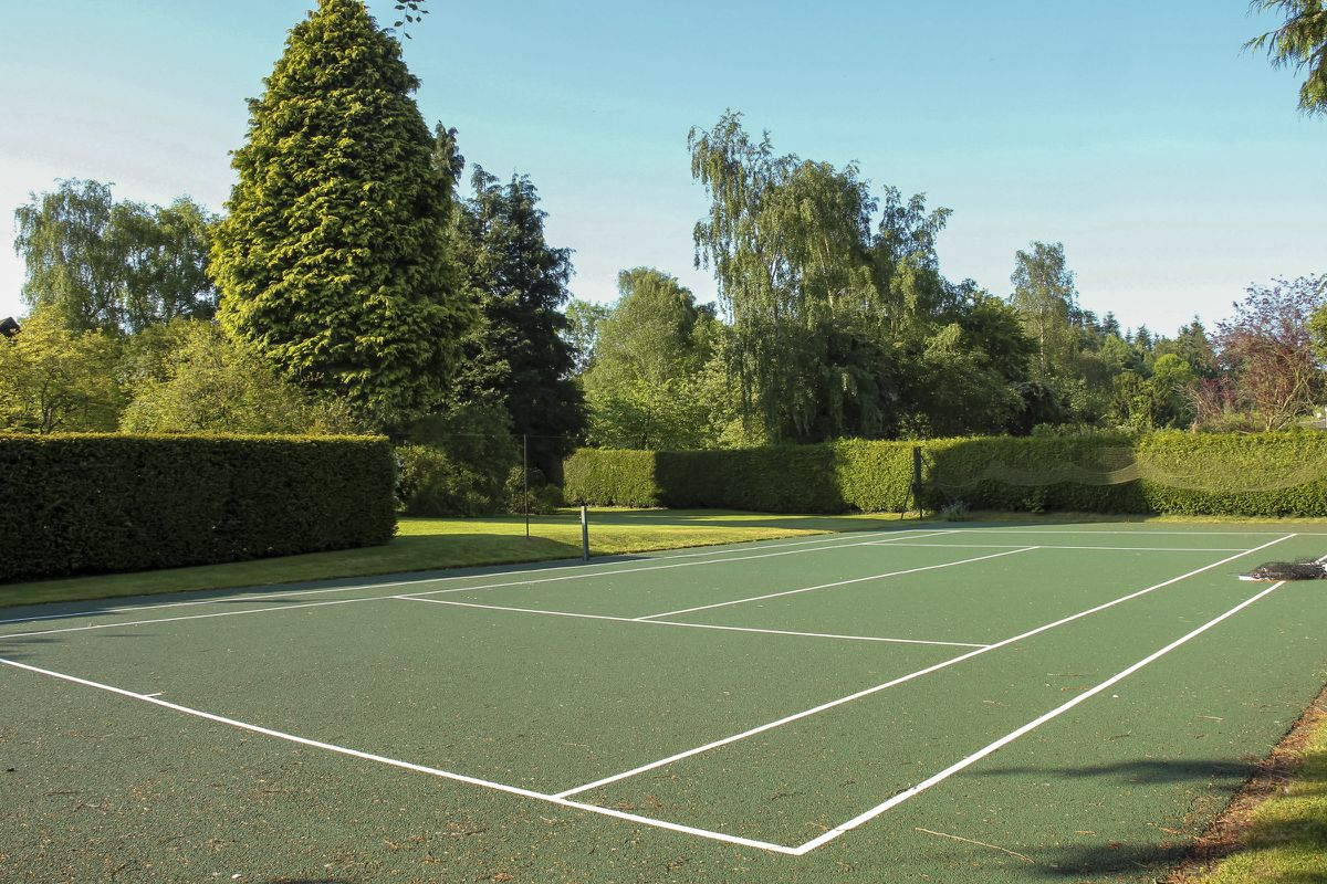 The house has its own tennis court