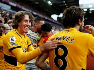 BIRMINGHAM, ENGLAND - OCTOBER 16: Fabio Silva (L) and Ruben Neves of Wolverhampton Wanderers celebrate their team's second goal during the Premier League match between Aston Villa and Wolverhampton Wanderers at Villa Park on October 16, 2021 in Birmingham, England. (Photo by Jack Thomas - WWFC/Wolves via Getty Images).
