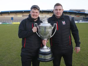 Shifnal Town joint managers Andrew Carrier and Danny Carter with the TJ Vickers Shropshire FA Premier Cup Pic: James Baylis